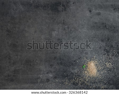 Dark grey grunge cooking backdrop with brown sugar and mint leaf. Surface, background and wallpaper. Horizontal - stock photo