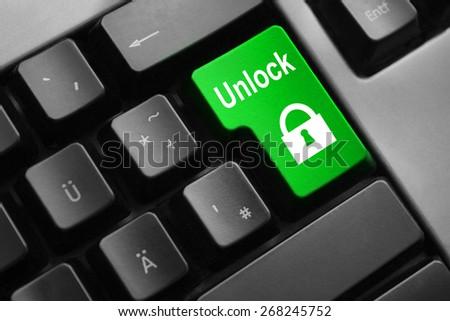 dark grey keyboard green enter button unlock - stock photo
