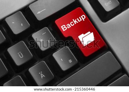 dark grey keyboard red button backup folder online - stock photo