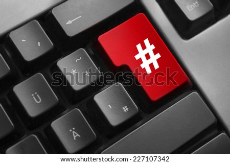 dark grey keyboard red enter button hash symbol - stock photo