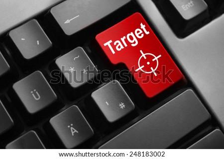 dark grey keyboard red enter button target crosshair - stock photo