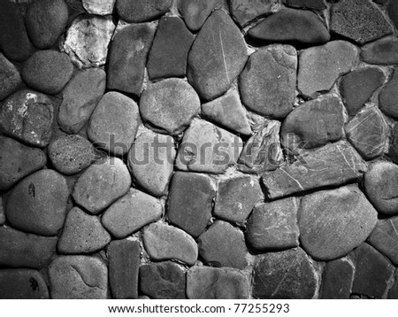 Dark grey medieval stone wall background or texture - stock photo