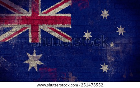 Dark Grunge Australian Flag on an old Brick Wall - stock photo