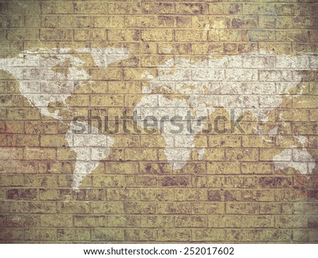 Dark Grunge Map of the world painted on an old Brick Wall. -original map from NASA - stock photo