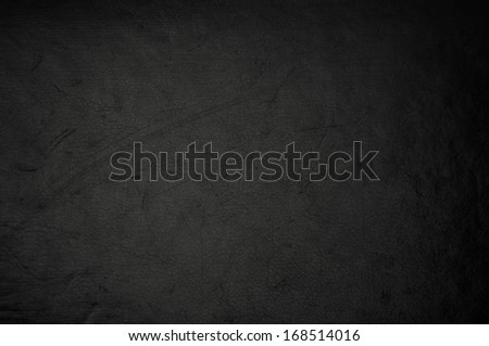 dark grunge scratched leather to use as background - stock photo