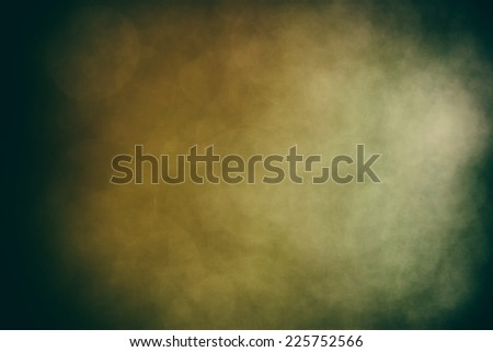 dark Grungy background with vignette and green and brown colors - stock photo