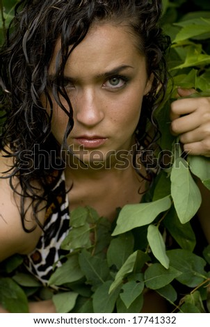 Dark-haired beauty facing camera with a print top on - stock photo
