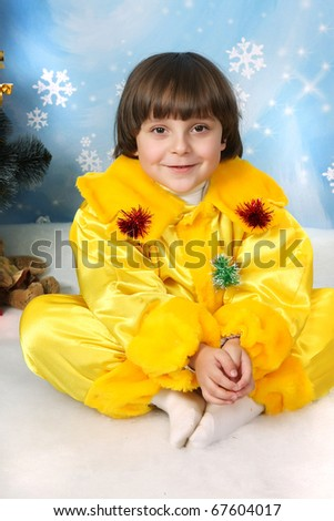 dark-haired boy in a yellow costumes