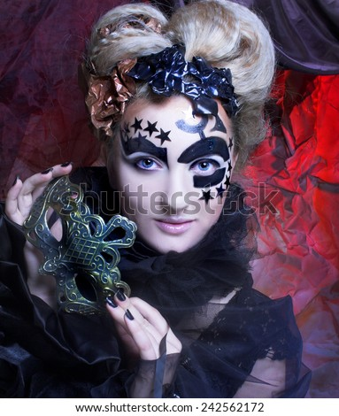 Dark Halloween  Lady. Portrait of young woman posing with mask - stock photo