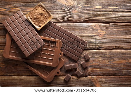 Dark homemade chocolate and cocoa - stock photo