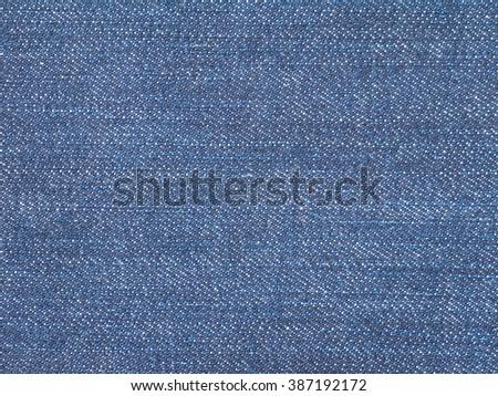 Dark indigo jeans denim fabric closeup background - stock photo