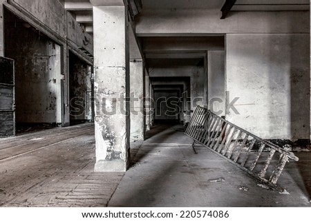 Dark industrial interior of an old building - stock photo