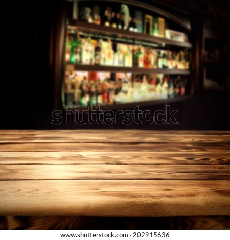 dark interior and wooden table bar  - stock photo