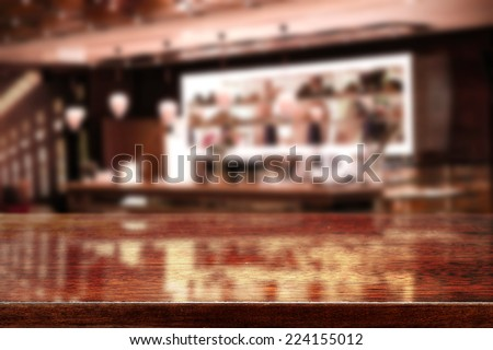 dark interior of bar and brown desk with reflection  - stock photo