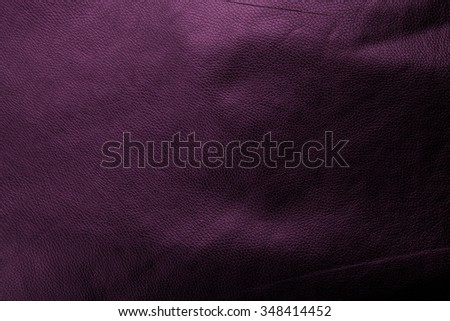 dark leather abstract purple background with vintage grunge background texture design with center spotlight and solid purple color web template background or brochure layout  - stock photo