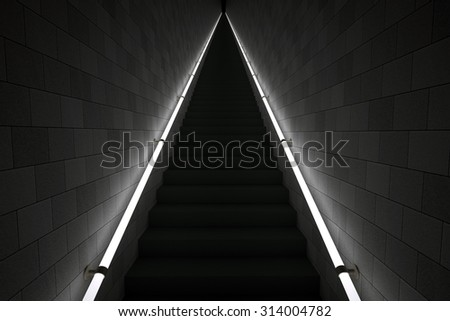 Dark, long steps with hand rails. - stock photo