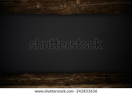Dark metal plate with wooden inserts - stock photo