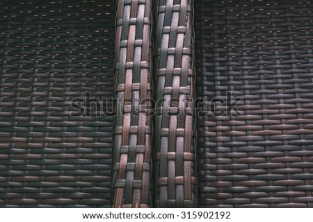 Dark modern and contemporary beautiful brown plastic weave fabric pattern or texture suitable for backgrounds or website wallpaper