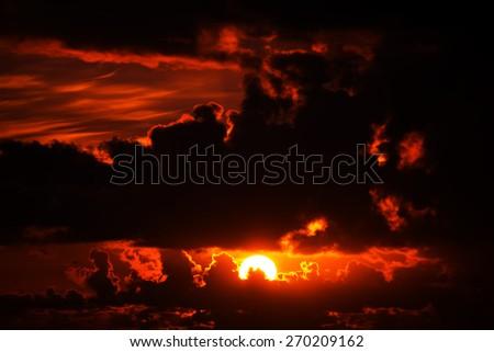 dark moody red sunset sky in the wild atlantic way - stock photo