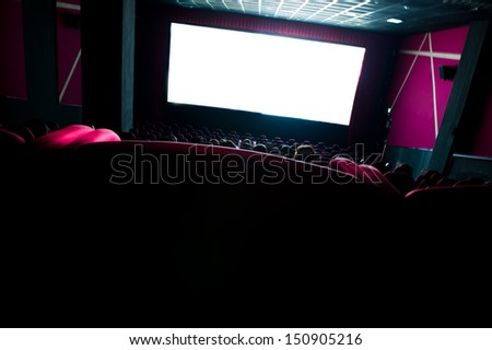 Dark movie theatre interior. tilted screen, chairs - stock photo