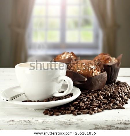 dark muffins and coffee  - stock photo