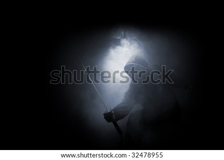 dark ninja in the smoke - stock photo
