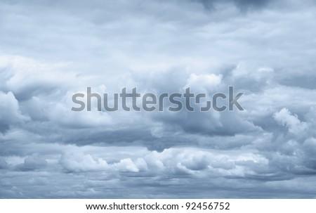 Dark ominous clouds. Dramatic sky - stock photo