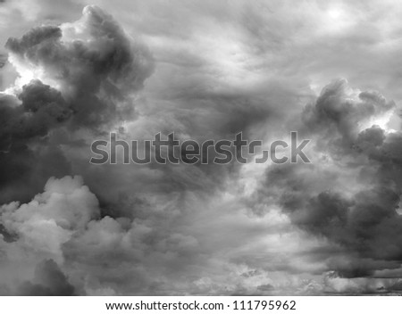 Dark ominous clouds. Dramatic sky background - stock photo