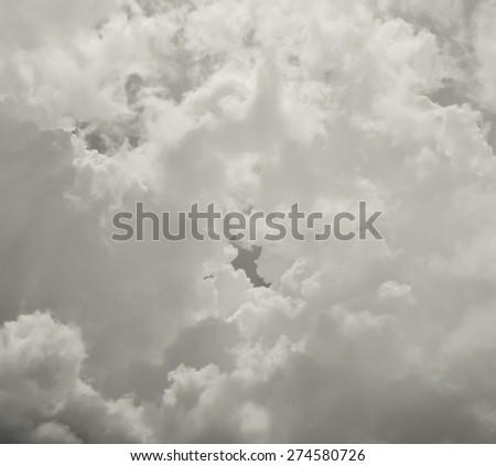 Dark ominous gray storm clouds. Dramatic sky. - stock photo