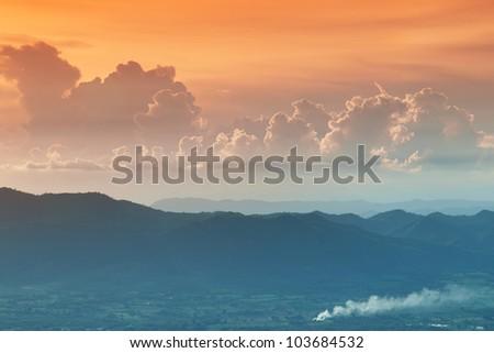 dark orange sky and clouds - stock photo