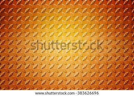 dark orange steel texture. industrial shiny metal silver list with rhombus shapes. - stock photo