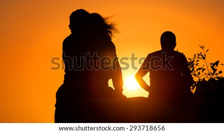 dark people and sunset background - stock photo
