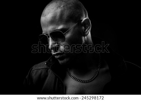 Dark photos of a mysterious young man with sunglasses