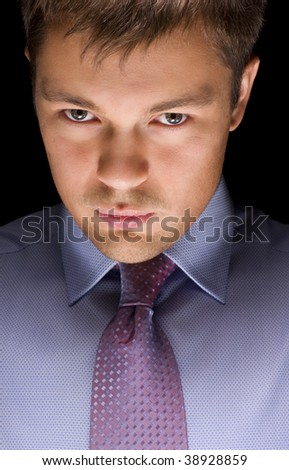dark picture of confident businessman face over black - stock photo