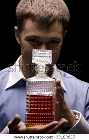 dark picture of man with a bottle - stock photo