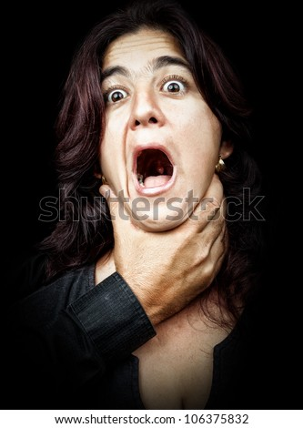 Dark portrait of a woman being abused and strangled by a man while she screams - stock photo