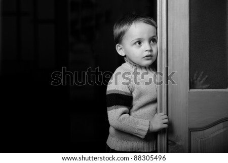 dark portrait of small boy - stock photo