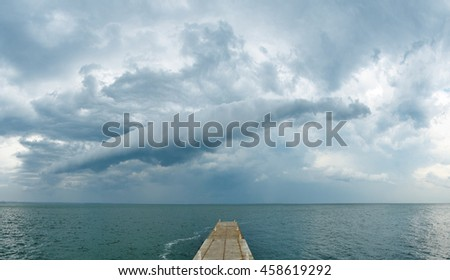 Dark rainy clouds over the Black Sea. Stormy weather. Panoramic view - stock photo