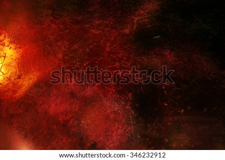 Dark red grunge background with scratchy texture and gold shine