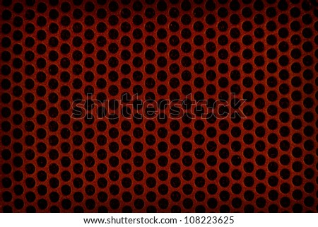 Dark red perforated plastic background