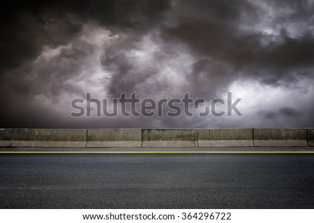 Dark road and dark sky on stormy weather
