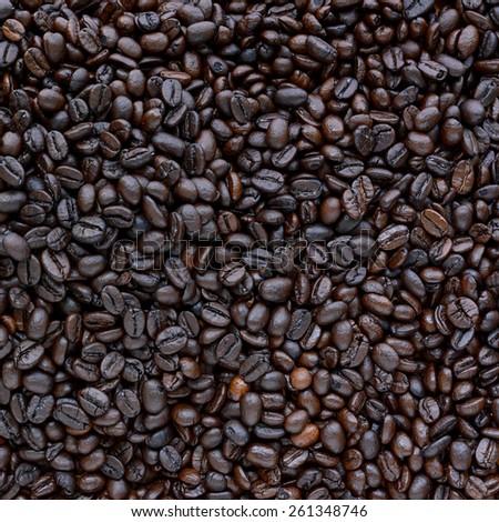 Dark roasted coffee beans - soft focus - stock photo