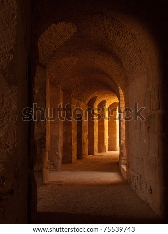 "dark roman coliseum hall, ""El Djem"" Tunisia - stock photo"
