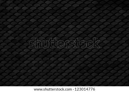 Dark roof tile - stock photo