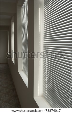 Dark room with blinds - stock photo