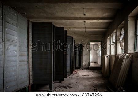 Dark room with steel lockers - stock photo
