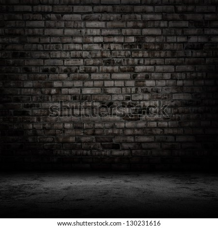 Dark room with tile floor and brick wall background - stock photo