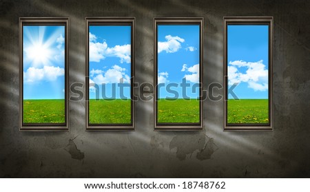 Dark room with windows overlooking blue sky and grass
