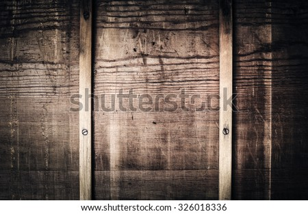 Dark rustic wooden background with nails
