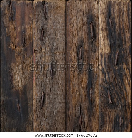 Dark rustic wooden planks with rustic nails background - stock photo